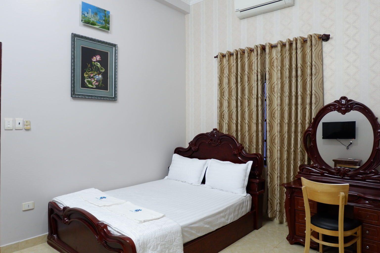 Hình ảnh phòng ngủ với giường đôi êm ái tại biệt thự Vũng Tàu Ali6B